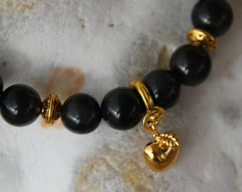 Obsidian with gold Apple charm