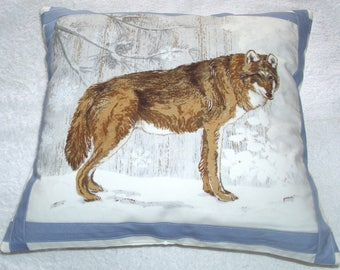 A Timber wolf in a winter forest cushion