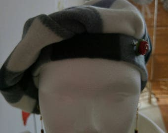White and black beret adorned wax d bee brooch