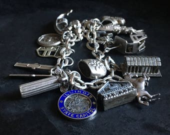 Sterling charm bracelet, vintage souvenirs of a traveller and skier.
