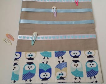 Large pouch tucks barrettes and elastics customizable blue owls.