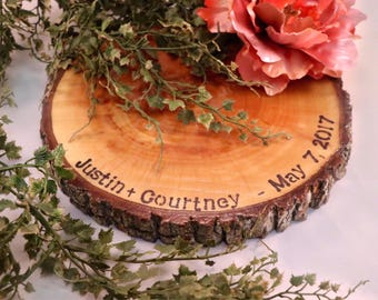 Personalized wedding centerpieces. Wood slice centerpieces, engraved centerpieces, engraved wood slices, wood slices, tree slices.
