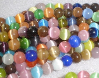 10 MIXED ŒIL CAT OPAL 6MM ROUND BEADS.