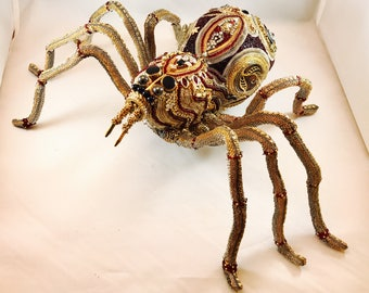 Wolf spider made from repurposed jewelry