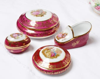 Four French porcelain LIMOGES items with delightful romantic scenes.