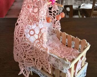 small bed of wood and lace