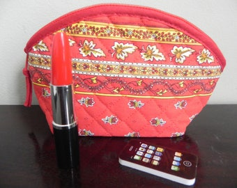 A humorous gift consists of a kit makeup + red lips + phone!
