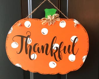 Double sided pumpkin door hanger, jack-o-lantern face on one side, thankful on one side, thanksgiving and Halloween reversible door hanger