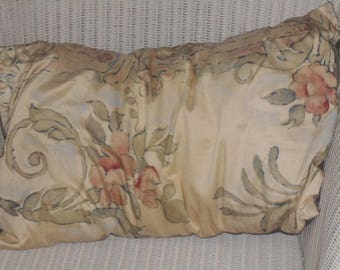 Oblong silk cushion cover.  Rich cream colour with earthy-coloured flower design