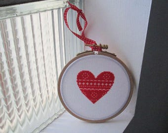 Round frame cross-stitched