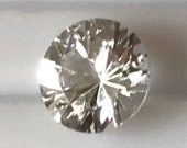 """A """"Folded"""" silver and 18 carat Rose Gold ring set with a White Sapphire measuring 4.5mm dis.."""
