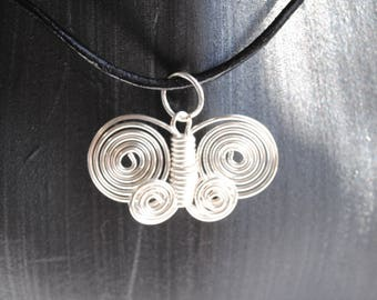 Beautiful handmade butterfly pendant necklace of a butterfly  handmade from silver copper wire hung on a black leather cord