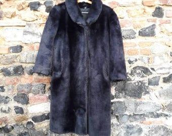 The black fur 100% Acrylic 70's coat