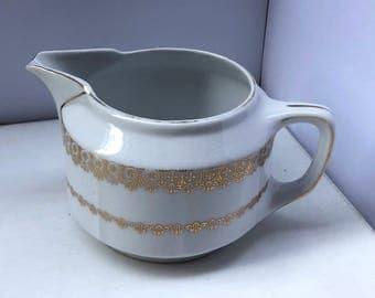 Vintage gold and white creamer pitcher