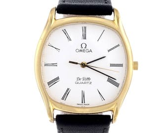 OMEGA - a gentleman's De Ville wrist watch. Gold plated case with stainless steel case back