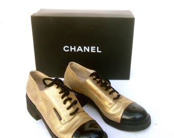 CHANEL Rare Super Chic Gold & Black Leather Spectator Lace Up Flats in Chanel Box Size 37