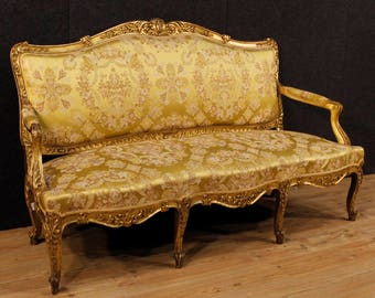 Antique golden sofa in Louis XV style of the 19th century