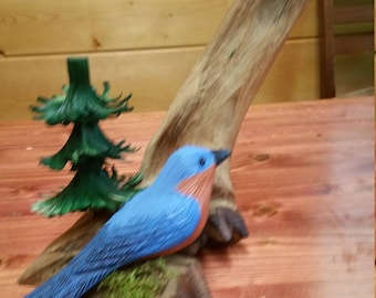 Handcarved wooden bird and tree