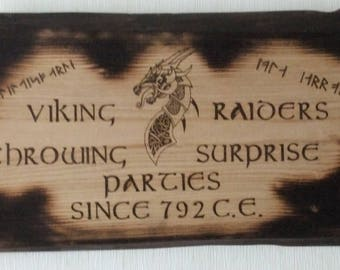 Pagan art; wooden plaque.