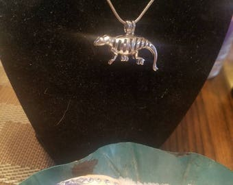Dinosaur Pendant with cultured pearl inside