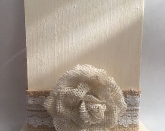 Table number with cream burlap in the middle