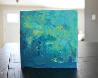Small abstract painting. Acrylic on wood panel. Turquoise, blue, yellow ochre. Gloss finish. 6 x 6 inches.