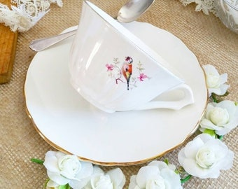Cup and saucer vintage birds