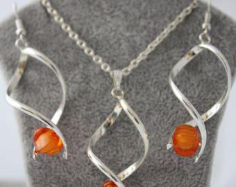 very pretty ornament with orange glass bead