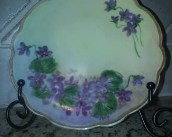 "Antique hand painted purple violets on a porcelain 5"" luncheon plate with scalloped gold edges, signed Markel 11 from M. Z. Austria"