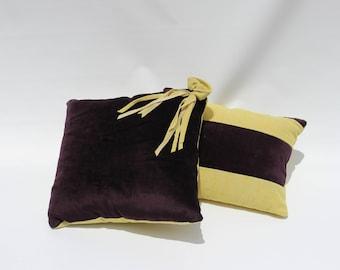 Dark purple and yellow decorative pillows
