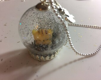 Globe necklace with a kitten inside and glitter.