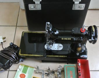 Singer 222K Featherweight Sewing Machine with attachments & instruction manual