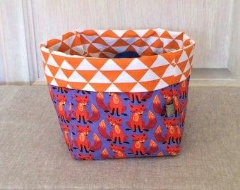 Reversible M fabric storage basket - coated cotton foxes/cotton orange triangles