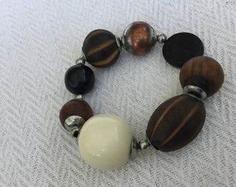 Carved Wooden And Plastic Bead Elasticated Bracelet