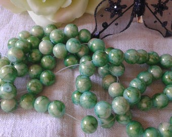 set of 15 glitter and marbled green beads, 10 mm