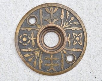 vintage door knob rosette with floral design / antique early 1900s rosette door hardware