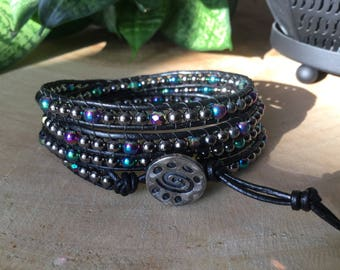 Leather, hematite and polished glass wrap bracelet.