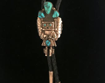 Vintage Navajo-made sterling silver and turquoise bolo tie with Navajo deity design, by artist Doris Smallcanyon