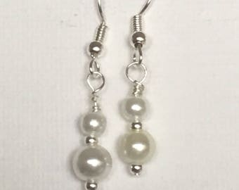 White pearl earrings. White pearl dangle earrings. White pearl drop earrings on silver ear wire.