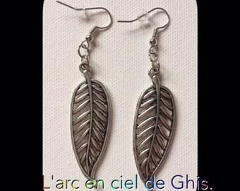 Earrings leaves prints.