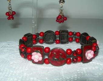 Red bracelet , enamelled, two swans, vintage, hand made,beads, flowers