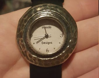 Pressed stainless steel watch