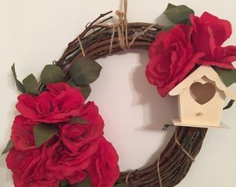 Large flower and bird house wreath