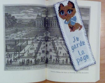 "Cat bookmark, inscription: ""I keep the page"""