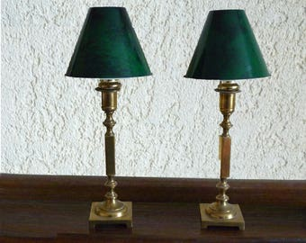 Pair of solid brass candlesticks with green metal shades.