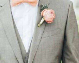 Coral, pink rose boutonnier