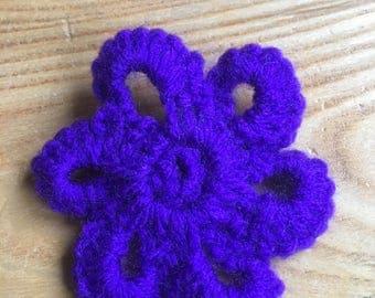 Hand crocheted purple flower brooch