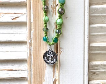 Beaded green hemp necklace with bling anchor pendant