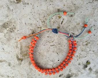 Adjustable ankle bracelet, orange glass beads, hemp cord