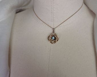 Blue zircon gold filled or 9ct love knot pendant